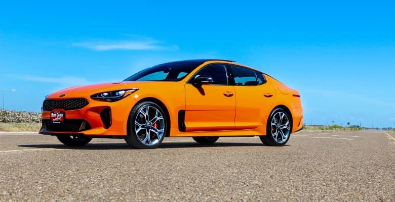 An orange Kia Stinger - Bert Ogden Harlingen Kia in Harlingen, Texas