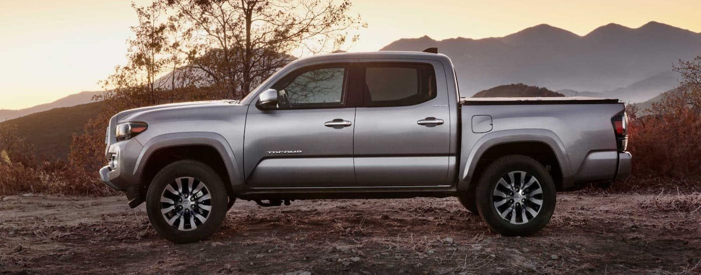 A silver 2020 Toyota Tacoma Limited is parked in the desert.