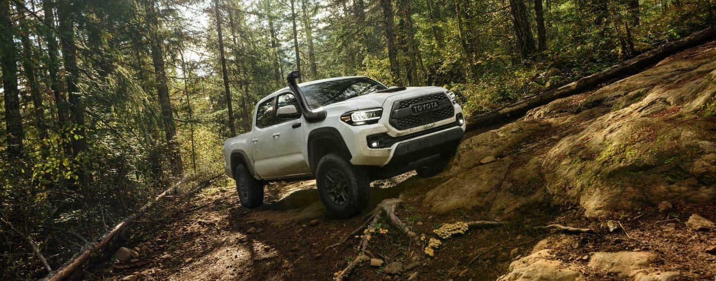 A white 2020 Toyota Tacoma TRD Pro with a snorkel exhaust is off-roading outside Indiana, PA.