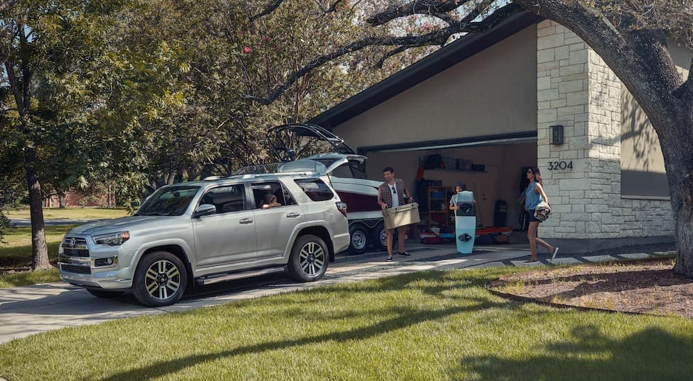 A family is loading up their silver 2020 Toyota 4Runner, which is popular among Toyota models, in the driveway of their Indiana, PA home.