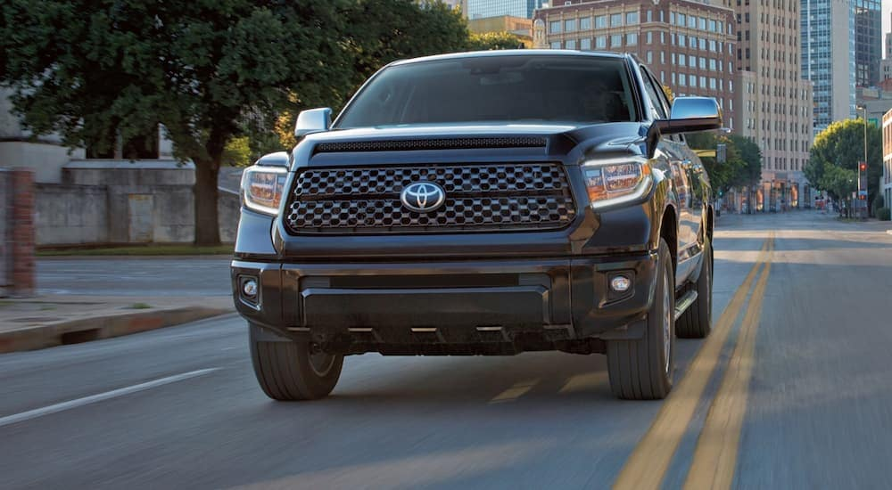 A black 2020 Toyota Tundra is driving on a city street near Indiana, PA.