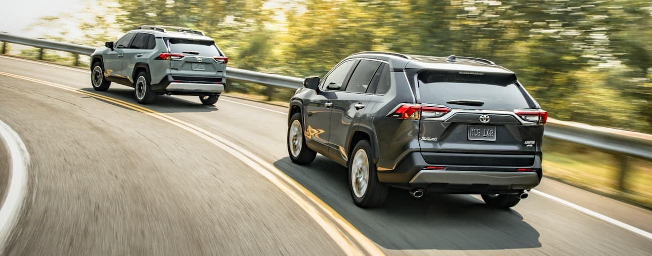 A light grey 2020 Toyota RAV4 is being followed around a corner by a dark grey one near Indiana, PA.