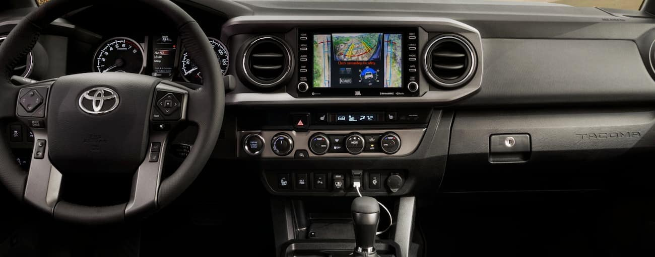 The black dashboard of a 2020 Toyota Tacoma is shown,