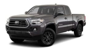 A dark grey 2020 Toyota Tacoma is facing left.