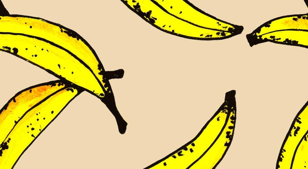 Pop art bananas are on a beige background, similar to Any Warhol's infamous painting.