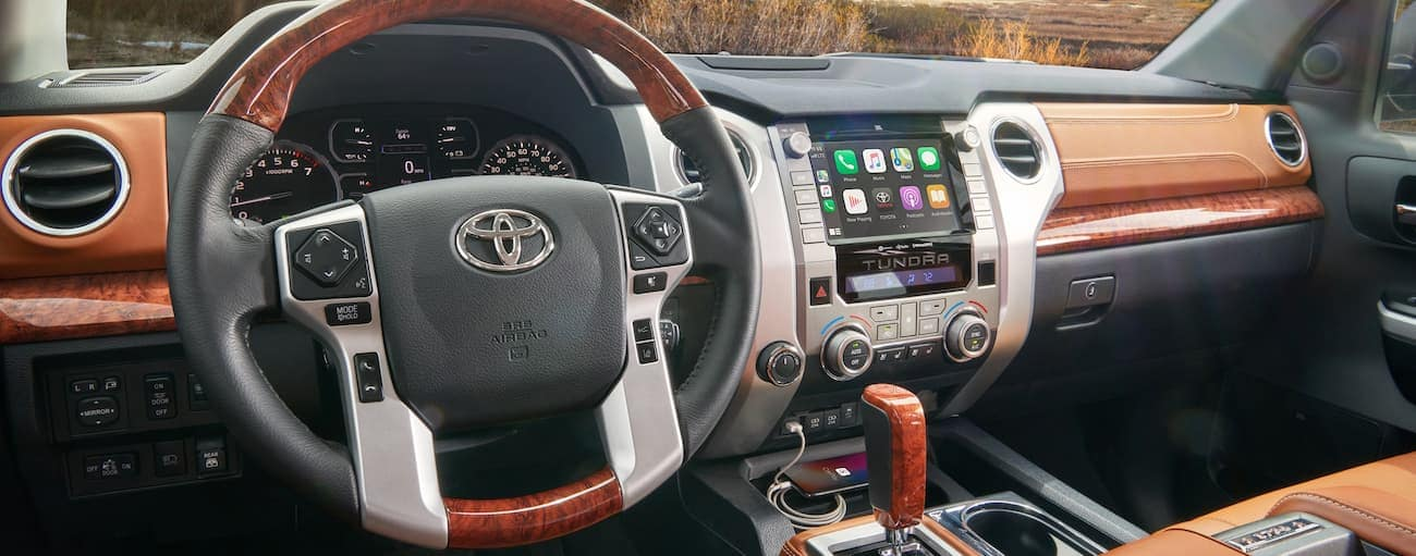 The wood grain dashboard is shown on a 2020 Toyota Tundra.