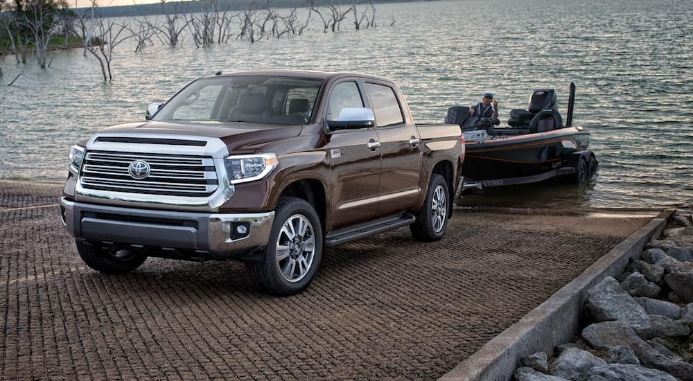 A brown 2020 Toyota Tundra is pulling a boat out of the lake after leaving a Toyota dealership near me in Indiana, PA.