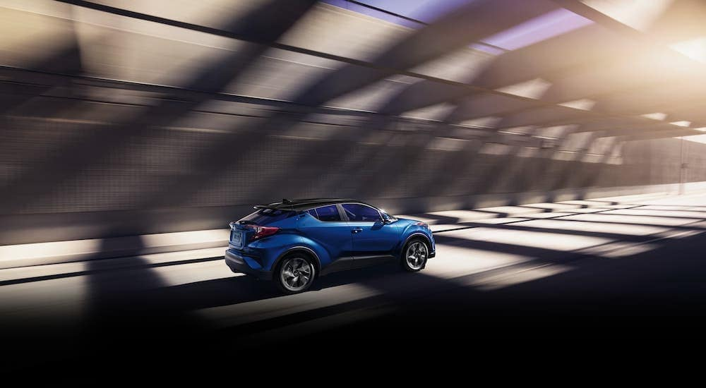 A blue 2019 Toyota CH-R is driving in a tunnel near Albany, NY.