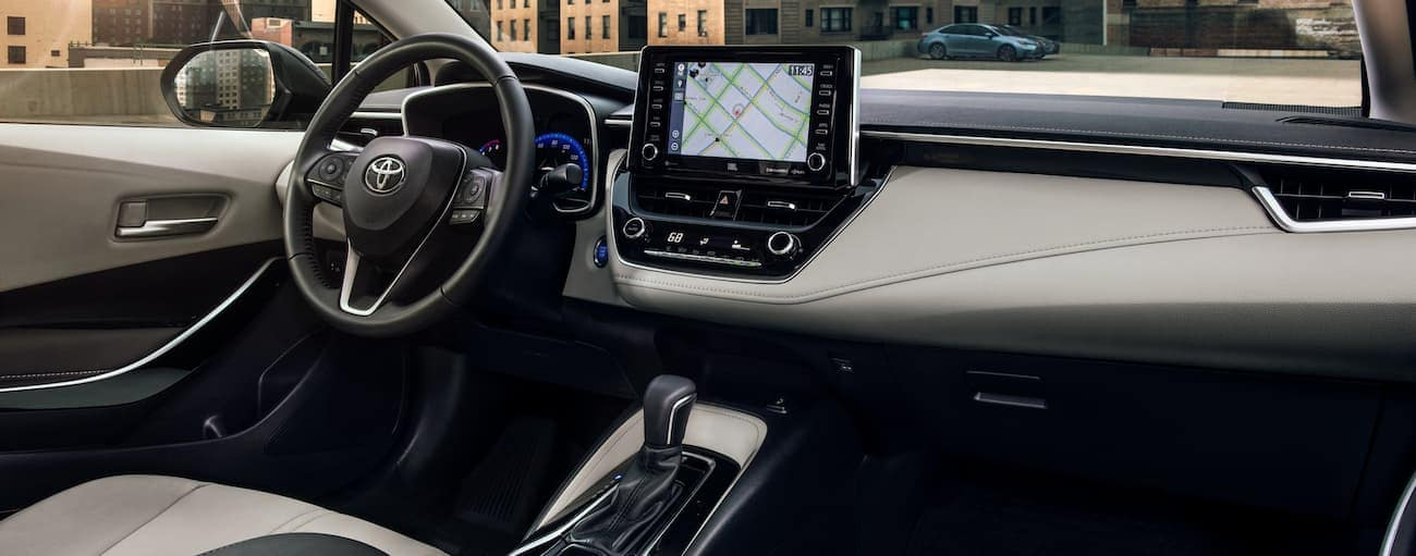 The black and white interior of a 2021 Toyota Corolla is shown.