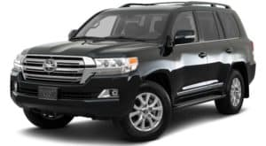A black 2021 Toyota Land Cruiser is angled left.