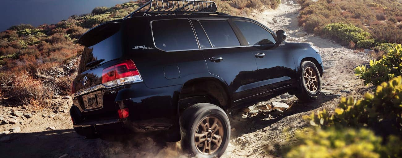 A black 2021 Toyota Land Cruiser is off-roading on a dirt trail outside Indiana, PA.