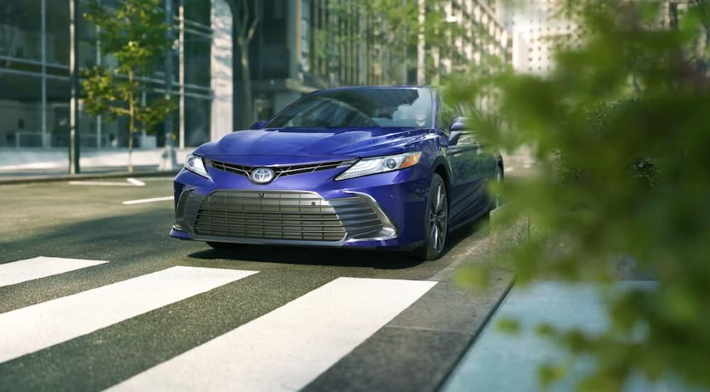 A blue 2021 Toyota Camry is at a city intersection in Indiana, PA.