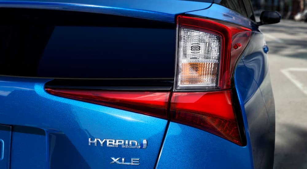 The badging on a blue 2021 Toyota Prius XLE, from a Toyota Prius dealership, is shown.