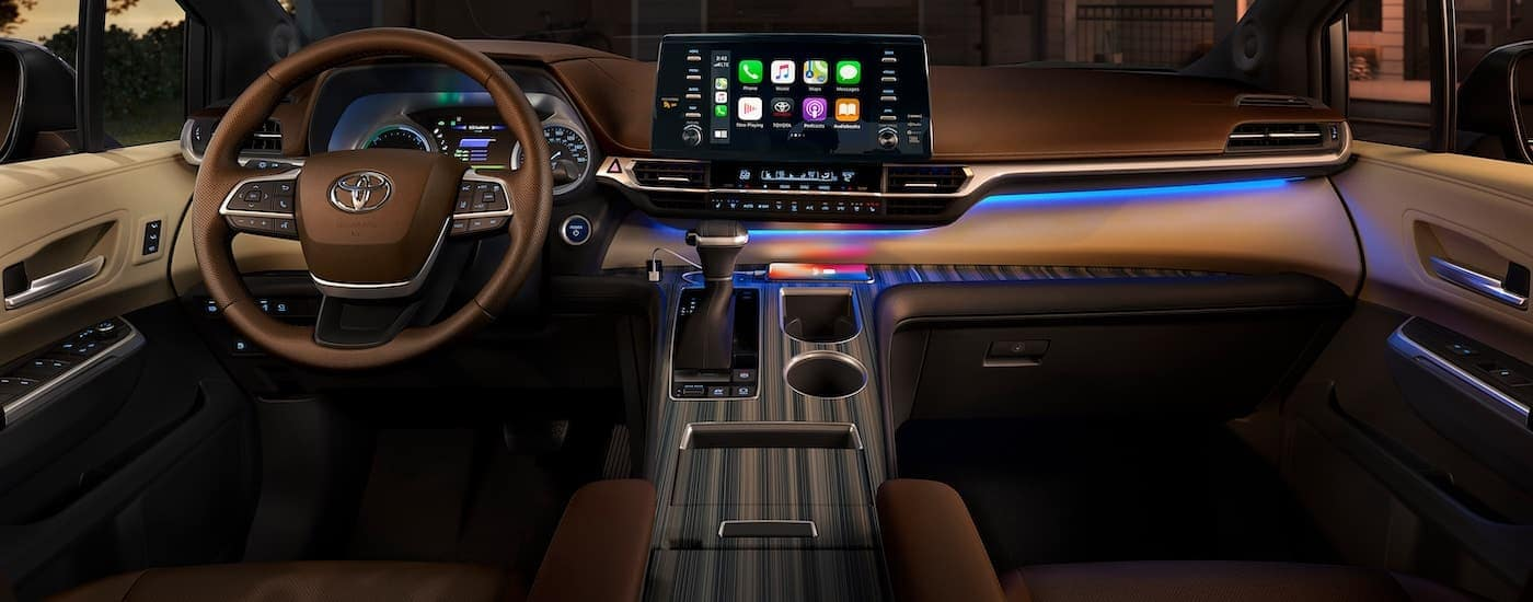 The brown interior and infotainment screen is shown on a 2021 Toyota Sienna.