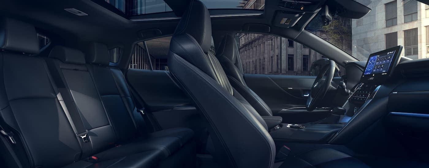 The black interior is shown from the passenger side of a 2021 Toyota Venza.