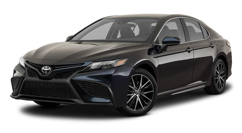A black 2021 Toyota Camry is angled left.