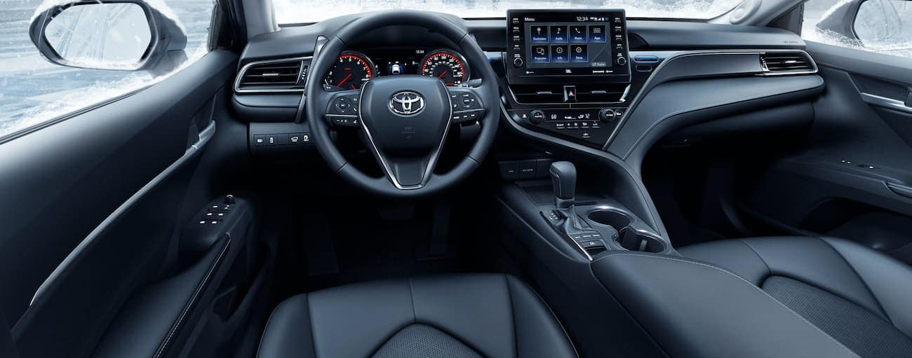 The black interior of a 2021 Toyota Camry is shown.
