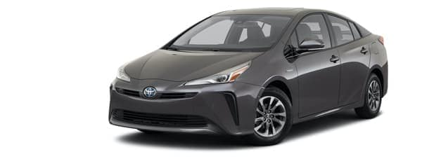 A dark gray 2021 Toyota Prius is angled left.