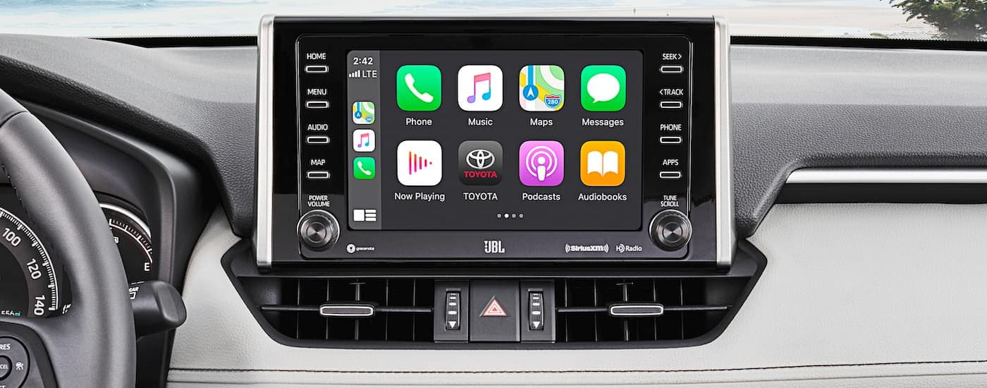 A close up shows the infotainment screen with applications on a 2021 Toyota RAV4.
