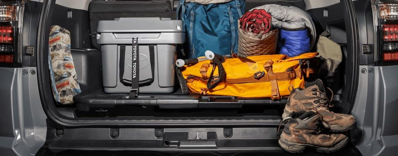 A grey 2021 Toyota 4Runner TRD Trail Special Edition is shown from the rear with the trunk full of cargo.