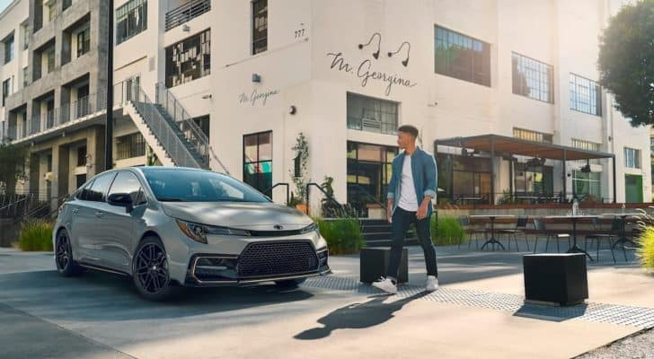 A grey 2021 Toyota Corolla XSE Apex Edition is shown from the front of a building.