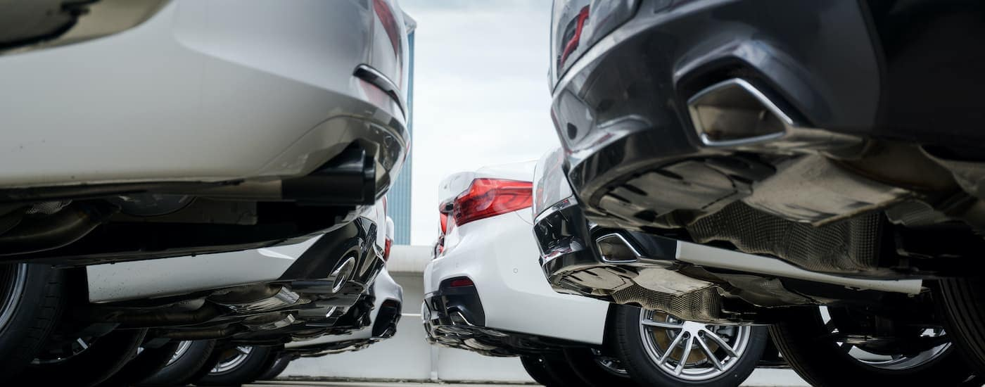 A close up shows the rear bumpers of two rows of cars at a Pennsylvania used Toyota dealer.