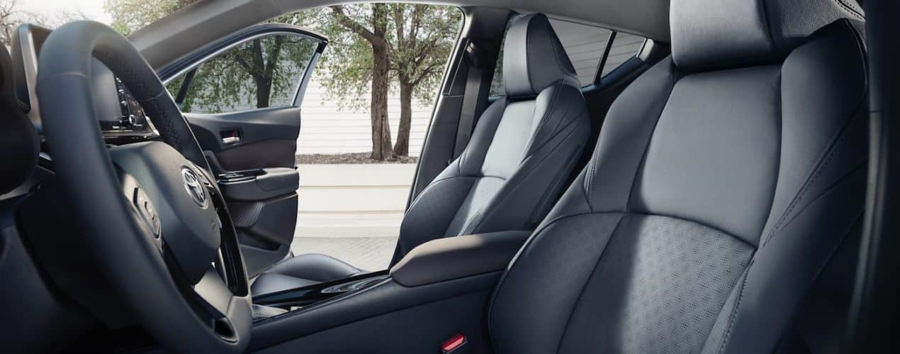 The black interior is shown from the drivers side in a 2021 Toyota C-HR Limited.