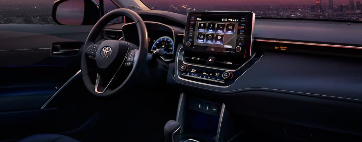 The interior of a 2022 Toyota Corolla Cross is shown at sunset.