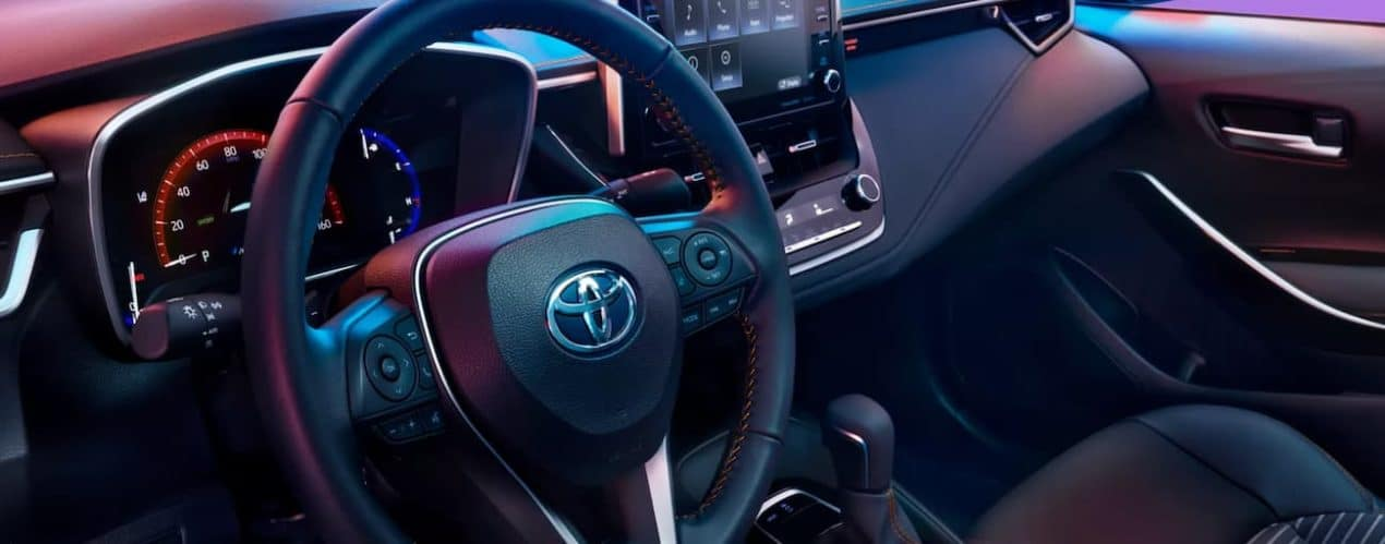 The interior of a 2022 Toyota Corolla XSE Apex shows the steering wheel in close up.