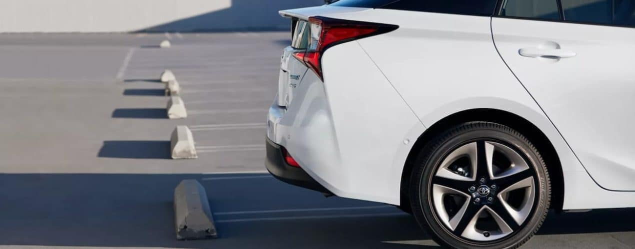 A white 2022 Toyota Prius XLE AWD is shown parked in a lot.