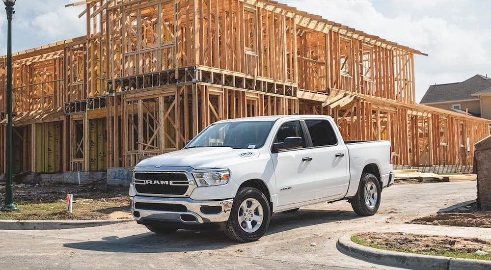 A white 2020 Ram 1500 is parked at a new home construction site near Defiance, OH.