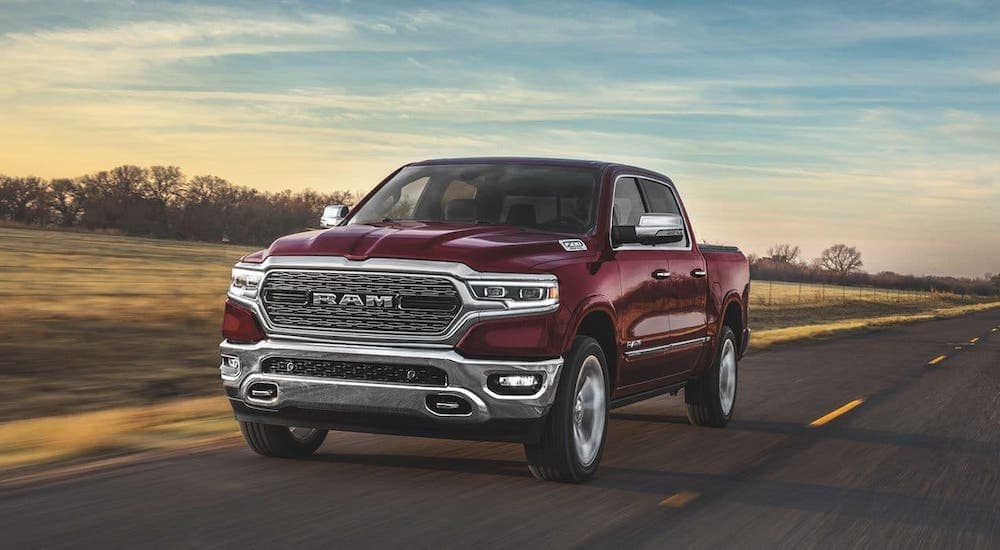 A red 2019 Ram 1500 is driving on a highway outside Defiance, OH.