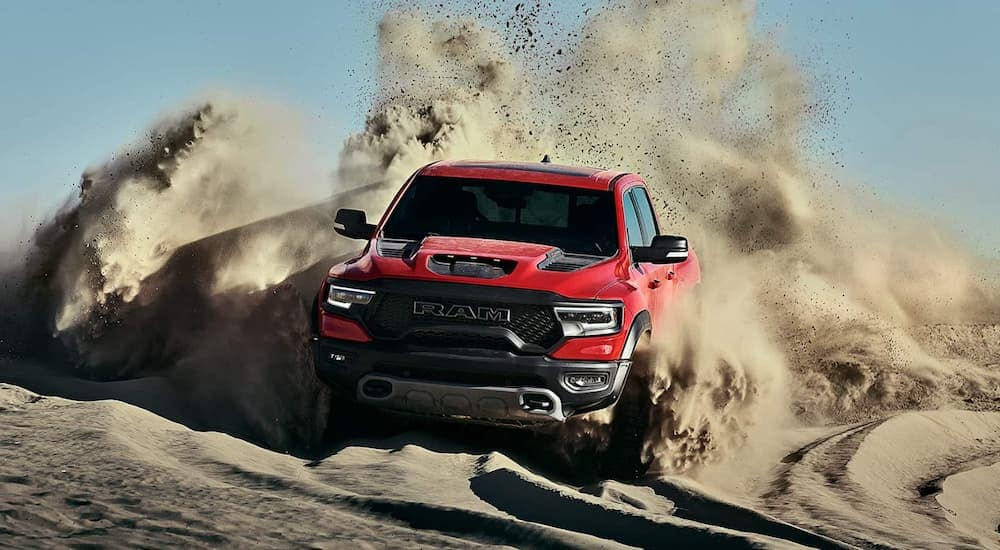 A red 2021 Ram 1500 TRX is kicking up sand while off-roading near Defiance, OH.