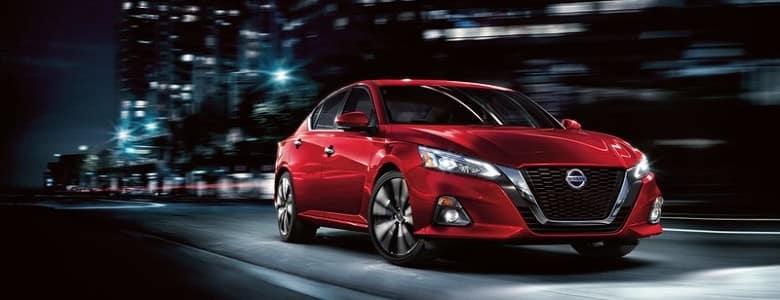 A red 2020 Nissan Altima - Fiesta Nissan in Edinburg, TX