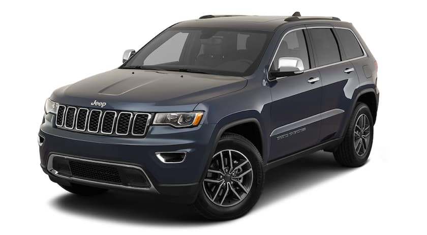 A dark blue 2020 Jeep Grand Cherokee is facing left.