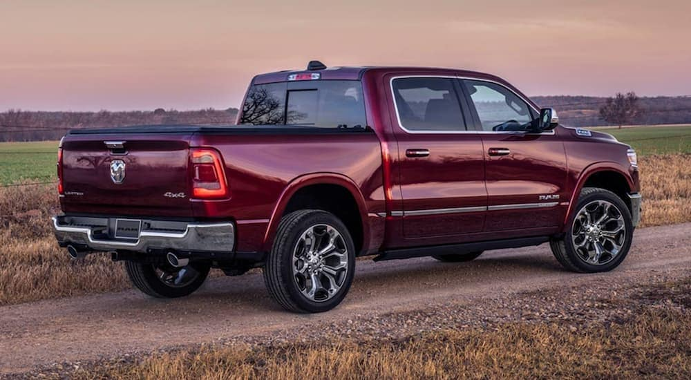 A burgundy 2020 Ram 1500 Limited is shown from the rear at sunset.