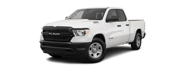A white 2020 Ram 1500 is angled left.