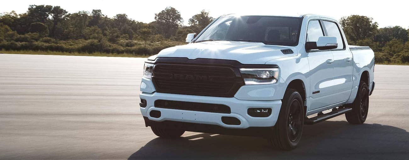 A white 2020 Ram 1500 is parked in an open lot after winning the 2020 Ram 1500 vs 2020 Ford F-150 comparison.
