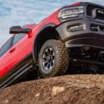 A red 2020 Ram 2500 Power Wagon is shown from a low angle while parked on a dirt mound.