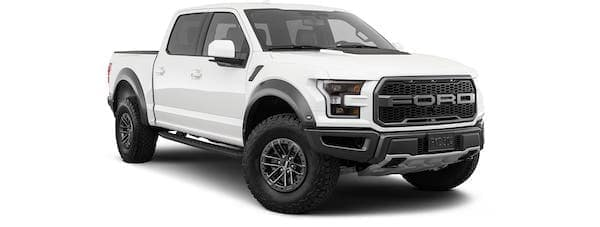 A white 2020 Ford Raptor is angled right.