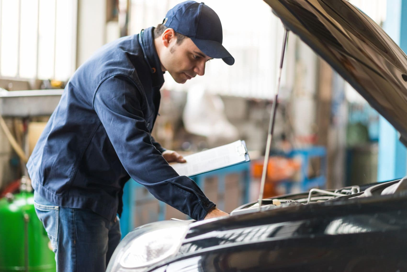 Mechanic servicing a used car