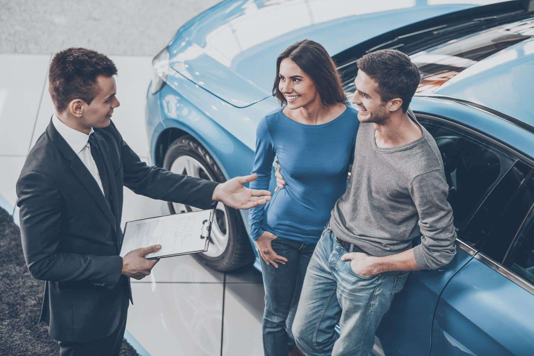 Man and woman buying a used car