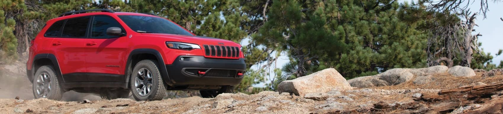 2021 Jeep Cherokee Trailhawk red on mountaintop banner