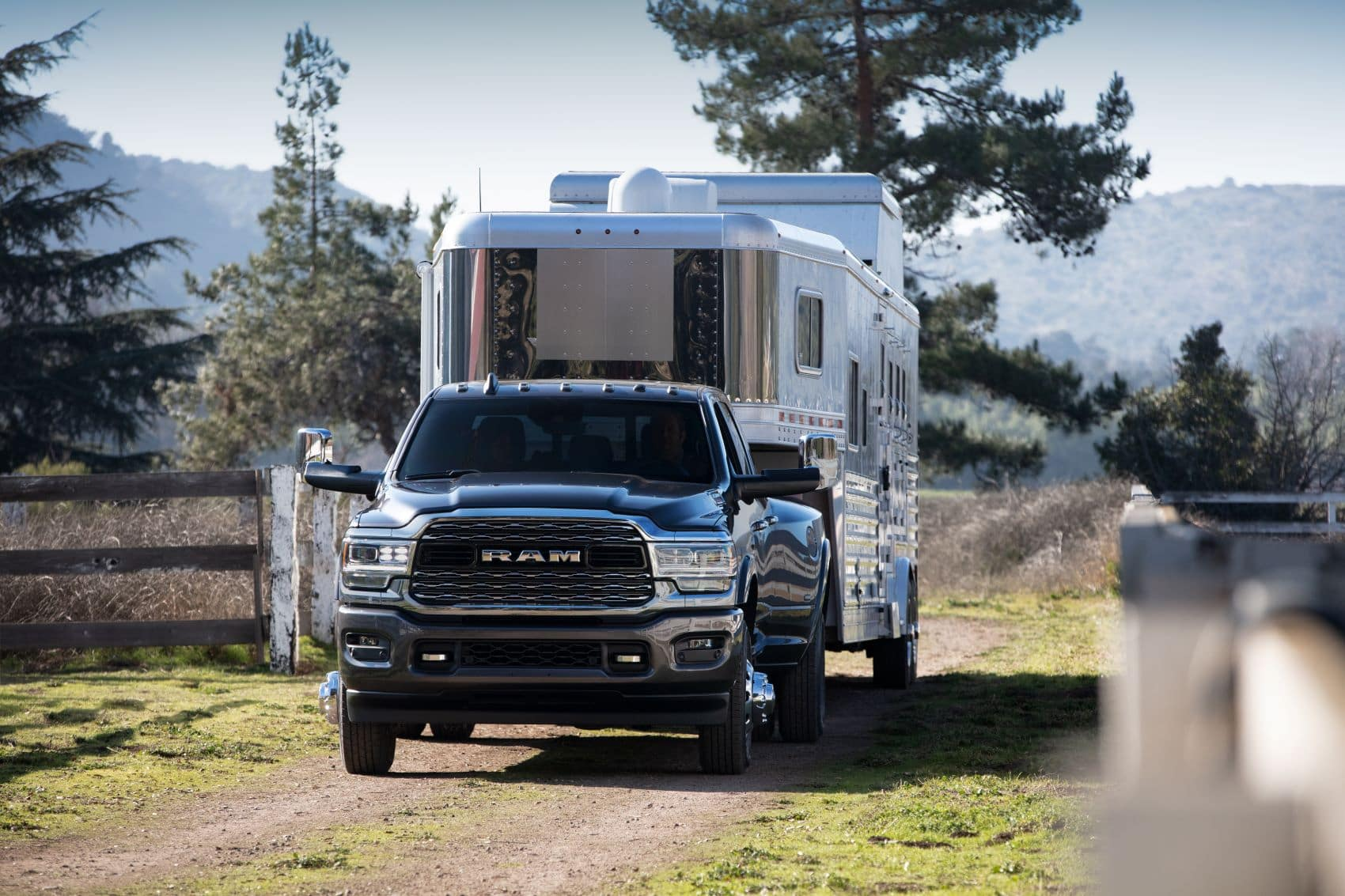 Ram 1500 truck towing a horse trailer