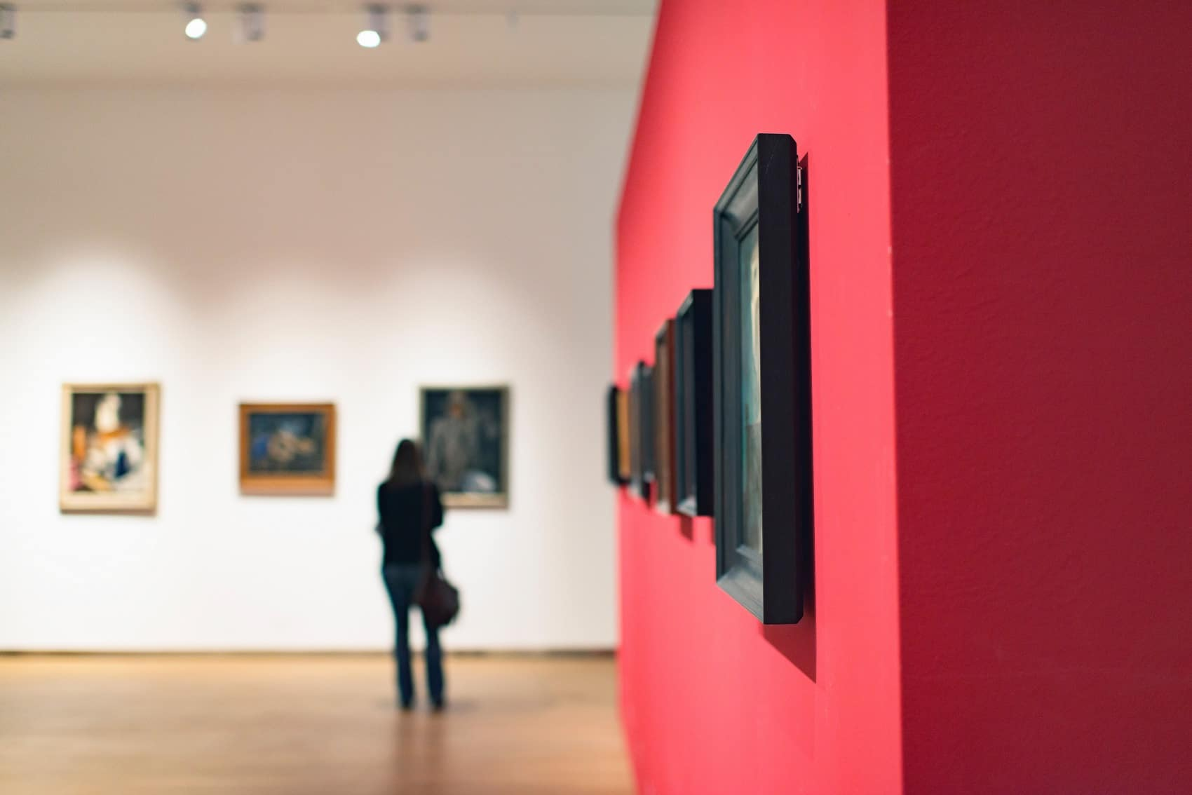 Woman looking at art in museum