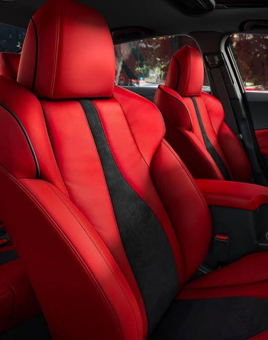 Red and black seats inside of an Acura vehicle
