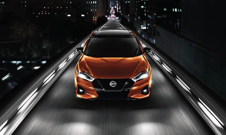2021 Nissan Maxima exterior driving on an overpass at night