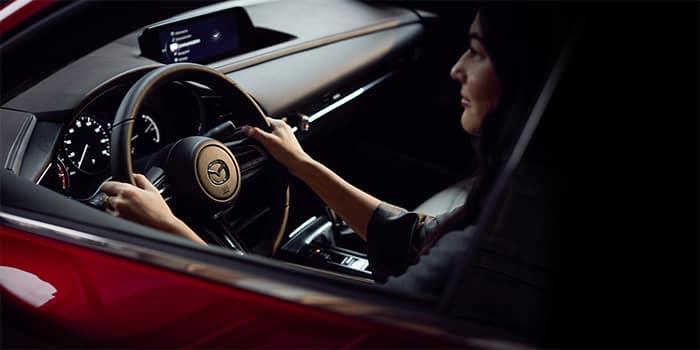 Woman driving a Mazda CX-30