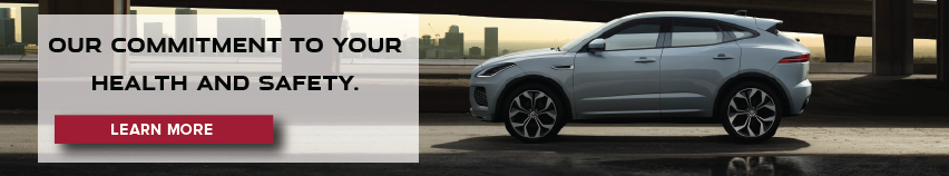 Black F-type on road near water. A message from our CEO about your health and safety. Click to learn more