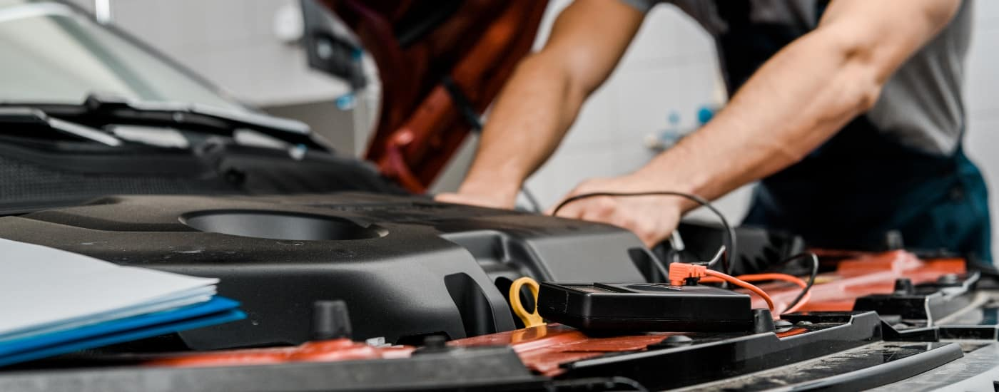 man installing new car battery